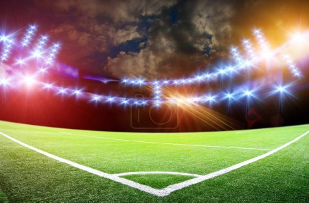Soccer stadium with bright lights under cloudy sky