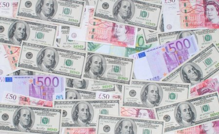 Pile of dollars, pounds and euro money banknotes