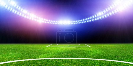 Green soccer field with bright lights