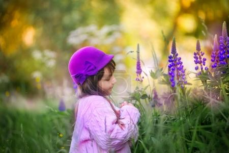 Outdoor girl portrait with meadow flowers