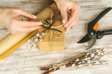 Woman decorating present