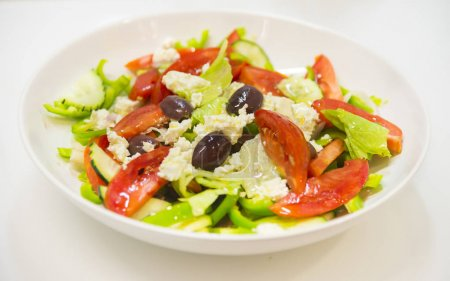 Greek salad with tomatoes, feta cheese and olives
