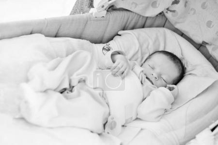 newborn in the crib