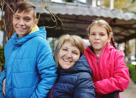 mather with son and daughter on the street