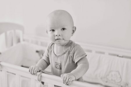 funny baby    in   bed