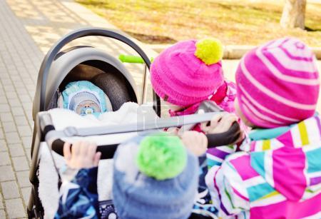 children walking with pram