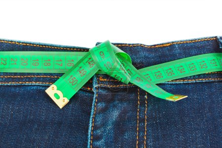 Jeans and measuring tape - slimming concept