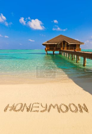Word Honeymoon on beach