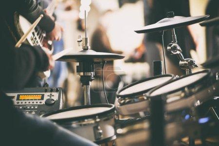 drummer plays on drums