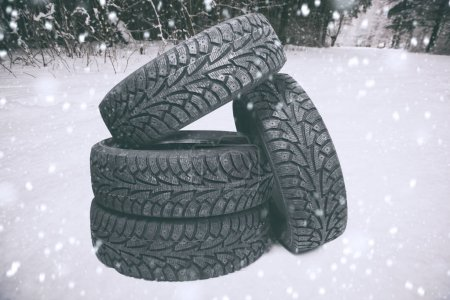 Four new tires on snow in the park