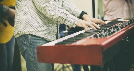 The young guy play the piano