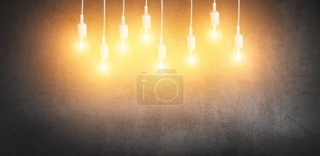 many light bulbs on grunge background