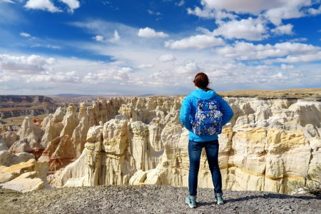 Hiker admiring views of sandstone formations