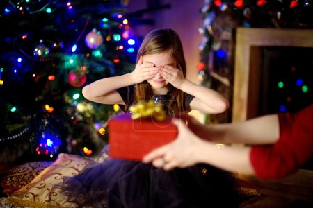 Little girl getting a Christmas gift