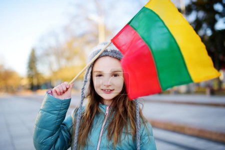Girl holding tricolor Lithuanian flag