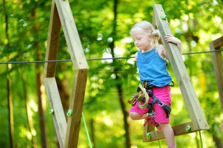 girl in climbing adventure park