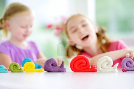 snails figures and little girls