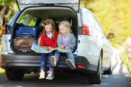Kids in car examining map