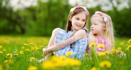Adorable little girls wearing wreaths