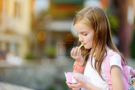 Girl eating tasty ice cream
