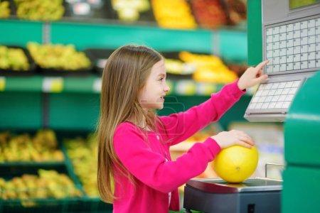 Cute little girl shopping