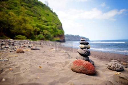Stack of balanced stones on beach
