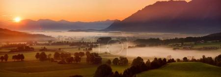 small Bavarian village covered in fog