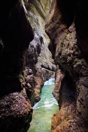 Blue water flowing in Partnach Gorge