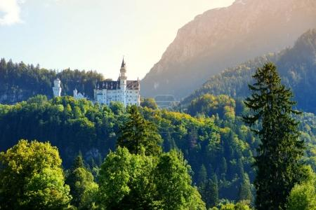 Romanesque Revival palace on rugged hill above village of Hohenschwangau near Fussen in southwest Bavaria, Germany