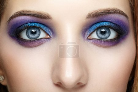 Photo for Closeup shot of female face eye with blue and violet makeup - Royalty Free Image
