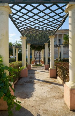 The colonnade passageway with pergola in the garden of Villa Big