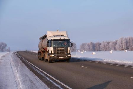 Scania truck on road M52 Chuysky Tract in winter season