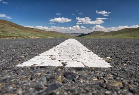 Wide-angle shot of empty road markings on asphalt in Mongolia be
