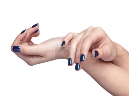 Female hands with blue Christmas fir-cone and shiny nails manicu