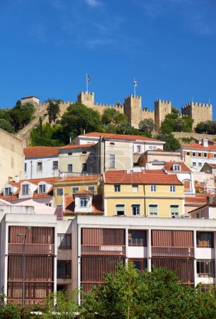 Saint George Castle surrounded by residential houses of Alfama.