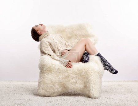 Brunette woman on furry arm-chair