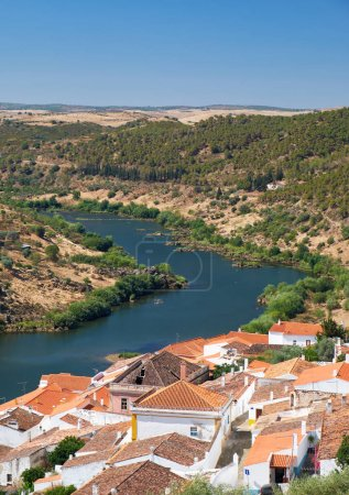 View of Guadiana river bend and residential houses of Mertola ci