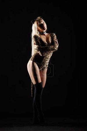 Blonde female dressed in cat girl. Woman in fancy masquerade cos