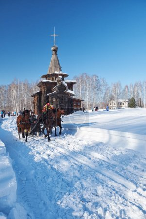 Troika of horses harnessed to a sleig. The Church of the Savior