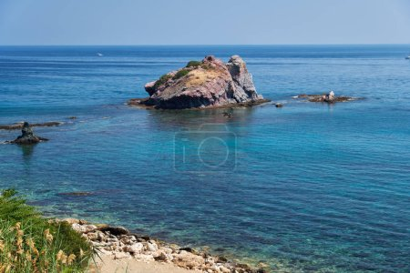 The view of the blue Takkas bay with large volcani...