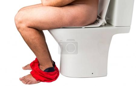 Man on the toilet isolated