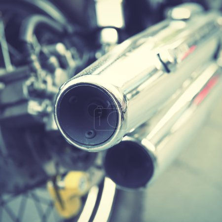 Chrome tailpipes of a motorbike