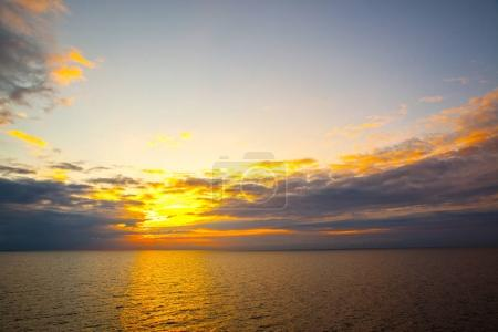 Photo for Sundown over sea - seascape at sunset with sea horizon - Royalty Free Image