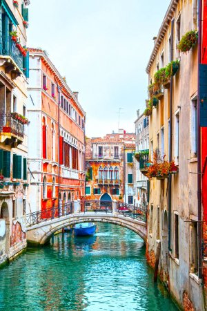 Photo for Narrow canal with small bridge in Venice, Italy - Royalty Free Image