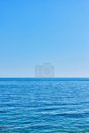 Photo for Sea horizon and clear sky - Vertical blue background with large space for your own text - Royalty Free Image