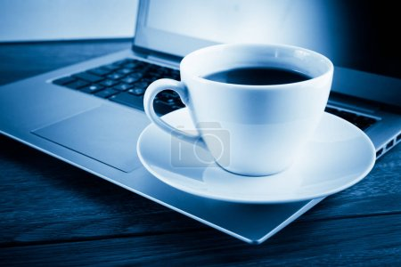 Cup of coffee and laptop