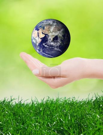 Hands holding and protect earth