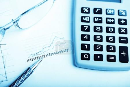 finance report with calculator and pen