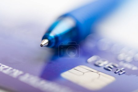 pen laying on credit card