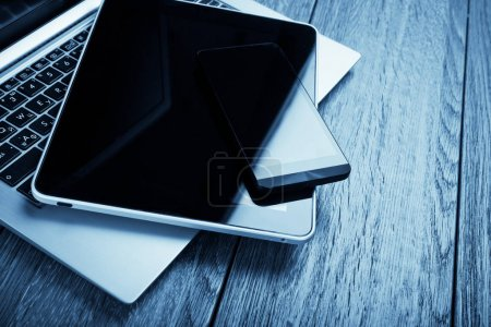 Laptop with smartphone and tablet